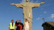Cardinal Orani Tempesta of Rio de Janeiro holds the Olympic flame Aug. 5 as Rio Mayor Eduardo Paes and former Brazilian volleyball player Isabel Barroso look on in front of the Christ the Redeemer statue. (CNS photo | Pilar Olivares, Reuters)