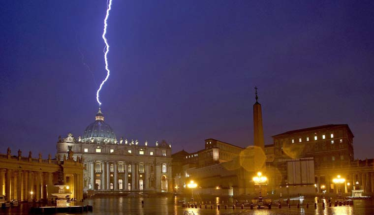 Lighting strikes the dome of St. Peter's Basilica in this Feb. 11, 2013 file photo. The Holy See has adhered to the U.N. Convention Against Corruption, an international treaty focused on preventing, outlawing and prosecuting corruption within nations and internationally. (CNS photo/Alessandro Di Meo, EPA) See VATICAN-CORRUPTION-ACCORD Sept. 23, 2016.