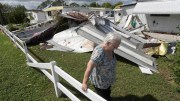 Cherie Monroe pauses after looking at the roof of her home Oct. 9 in the aftermath of Hurricane Matthew in Port Orange, Fla. (CNS photo/Phelan Ebenhack, Reuters) See US-HURRICANE-MATTHEW-RESPONSE Oct. 10, 2016.