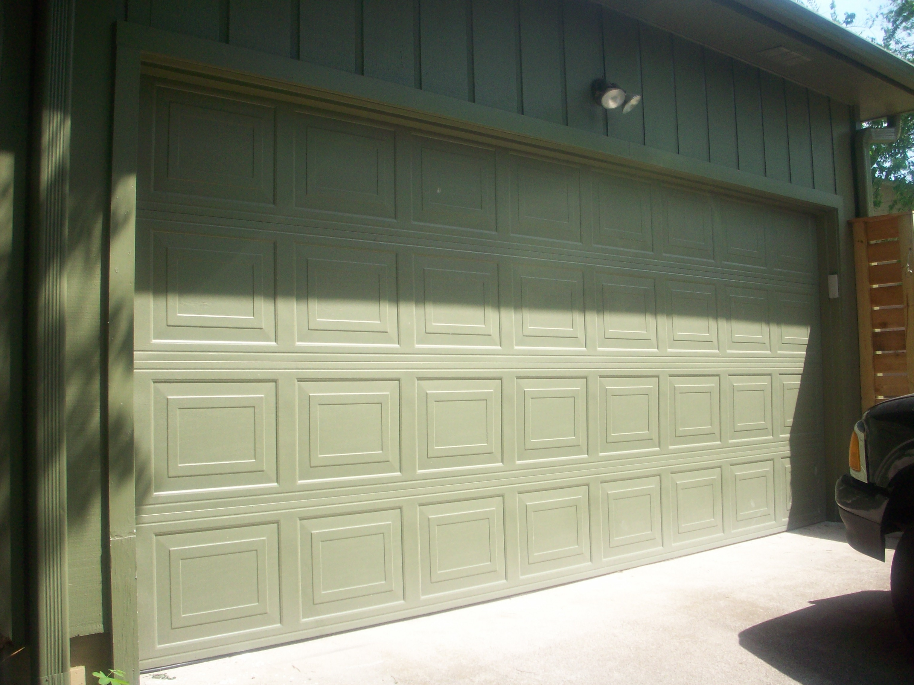 Here is the garage door with just one coat of bear rug don t worry i painted the outside door opener brown on the second coat