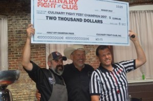 Nothing says winner like a giant check
