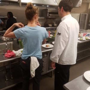 Instructor and student in kitchen