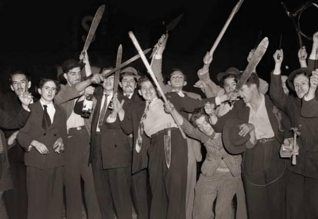 Machete-wielding workers during the Bogotazo by Sandy Gonzalez.