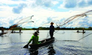 Fishermen cast their nets near Barrancabermeja, Santander.