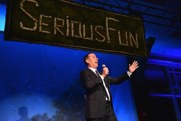 NEW YORK, NY - APRIL 04:  Comedian Jerry Seinfeld preforms during SeriousFun Children's Network event honoring Liz Robbins with celebrity guests at Pier Sixty at Chelsea Piers on April 4, 2013 in New York City.  (Photo by Larry Busacca/Getty Images for SeriousFun Children's Network)