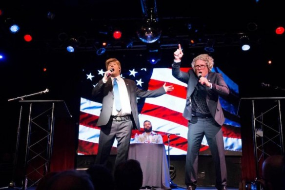 Anthony Atamanuik as Donald J. Trump engaged in a mock debate with James Adomian as Bernie Sanders, with Baratunde Thurston moderating, at a tour stop Feb. 12, 2016, at the Highline Ballroom in New York City. Photo by Mindy Tucker.