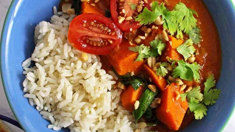 This peanut and sweet potato stew is spicy, filling and delicious. Add all your favourite toppings and serve with a healthy portion of rice or other grain.