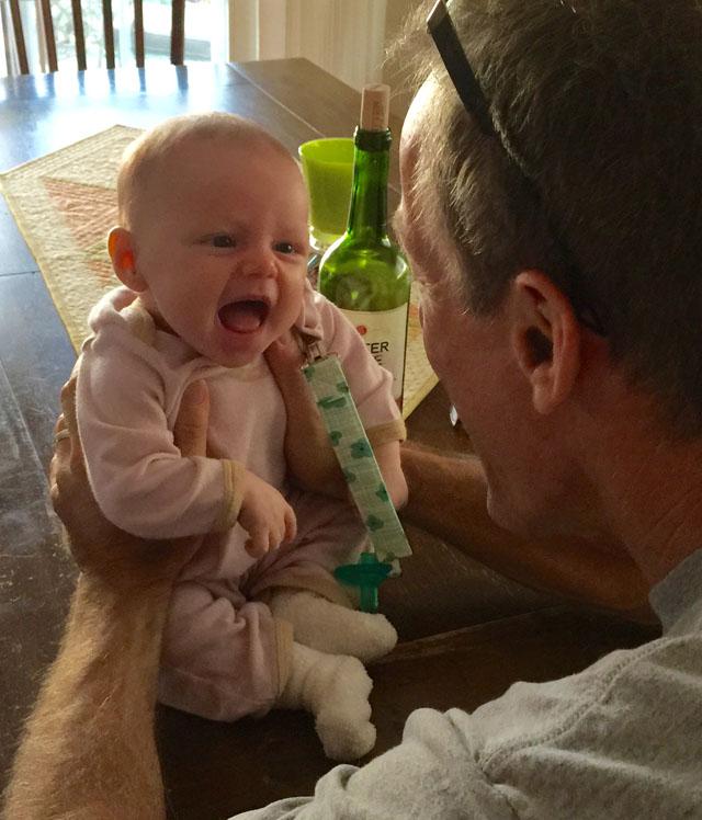 amelia smiling at grandpa