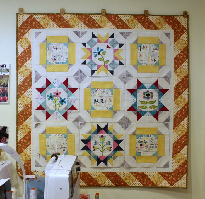 Maggie's First Dance BOM blocks on design wall at The Crafty Quilter