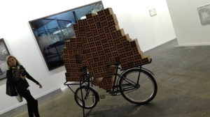 Hector Zamora, clay bricks, metal bicycle, 2013,galería Luciana Brito, brazil.
