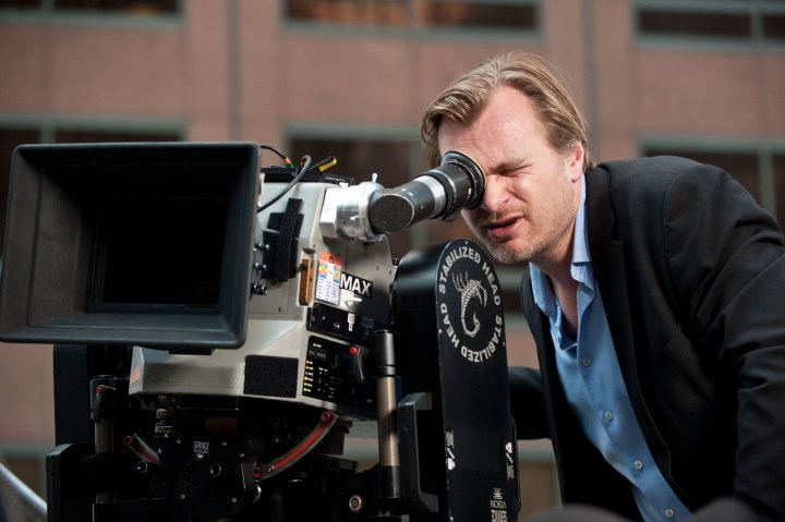 """Director CHRISTOPHER NOLAN sets up a shot for Warner Bros. Pictures' and Legendary Pictures' action thriller """"THE DARK KNIGHT RISES,"""" a Warner Bros. Pictures release. TM & © DC Comics."""