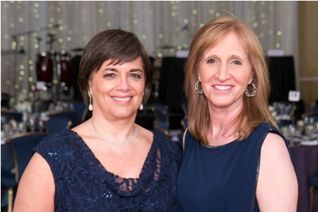 Event Co-Chairs Dr. Deborah Gisriel Bittar, left, and Susan Boltansky-Mann prepare for the evening's festivities.