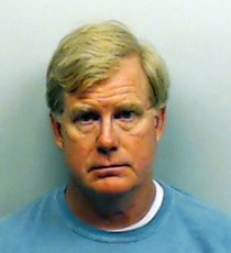 This photo provided Monday, Aug. 11, 2014 by the Fulton County Sheriff's Office, shows U.S. District Court Judge Mark Fuller after his arrest on a misdemeanor battery charge in Atlanta. (AP Photo/Fulton County Sheriff's Office)