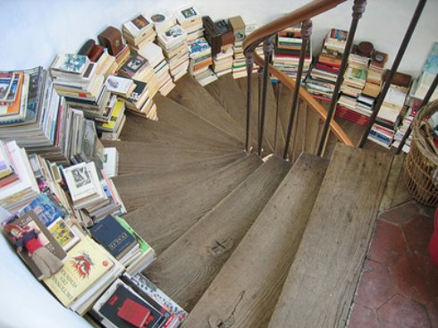 Books Stacked on Stairs Rethinking Bookcases