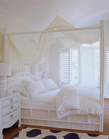 White bedroom with mosquito netting canopy Express Yourself