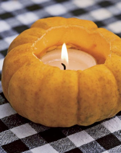 Pumpkin Votive via country living Easy Peasy Ways to Decorate a Pumpkin