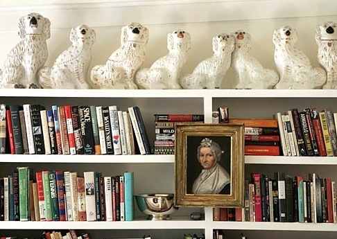 more art on bookcase via apartment therapy Ever Thought of Hanging Art Here?