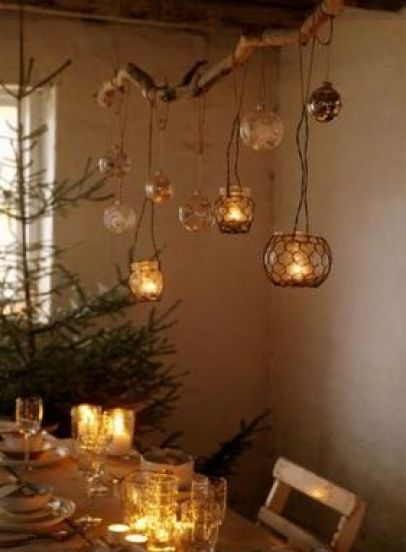 hanging lights on branches via desiretoinspire Christmas Decor Branches Out