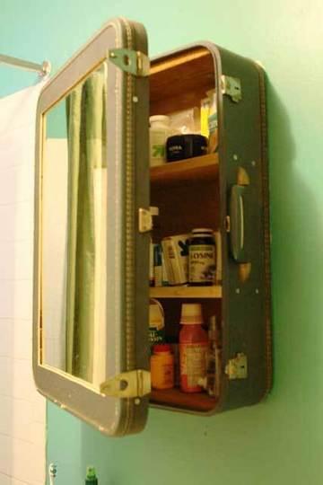 vintage medicine cabinet via re nest21 Clever Uses for Vintage Luggage