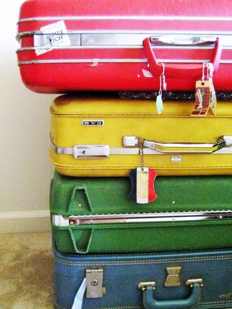 vintage suitcase table via texas inetgiant Clever Uses for Vintage Luggage