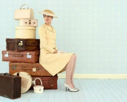 vintage woman with vintage luggage via whiteironstonecottage blogspot Clever Uses for Vintage Luggage