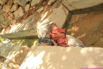 water flow through falaj is regulated by old rags