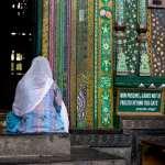 A Kashmiri woman prays at the entrance to The shrine of Mir Syed Ali Hamadani.