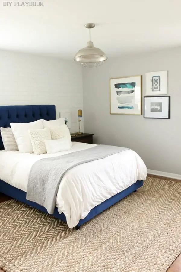 bedroom_gallery_wall_pillows_headboard