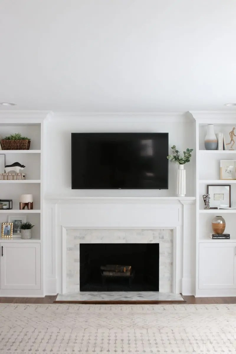 Painting An Old Fireplace A White Marble Tile Fireplace Update The Diy Playbook