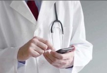 doctor using iphone (from Medscape video)