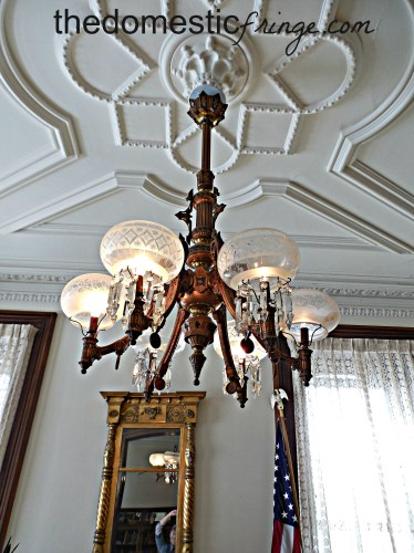 antique lighting fixture, mirror, American flag