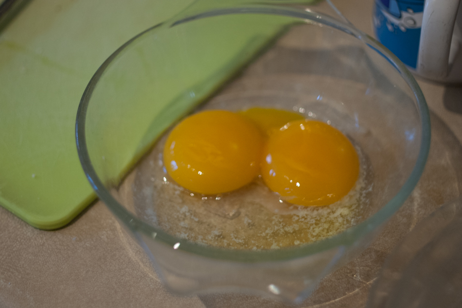 Egg yolks and melted butter, ready to whisk together