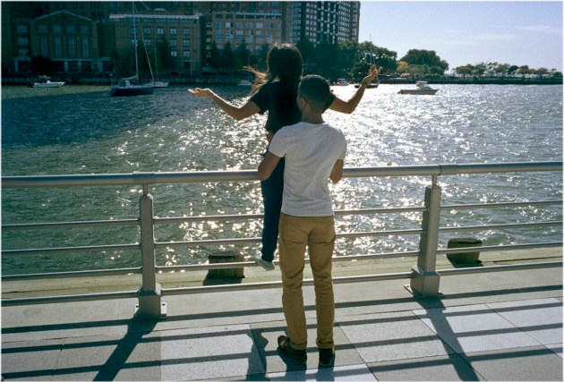 Teen couple facing harbor, 2012