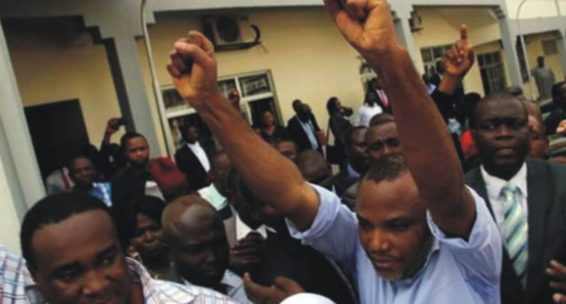 Nnamdi Kanu undaunted as he acknowledges cheers from supporters during his appearance in court in Abuja