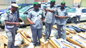 Customs officers inspecting the rifles