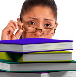 Lady Looking At Books Shows Education