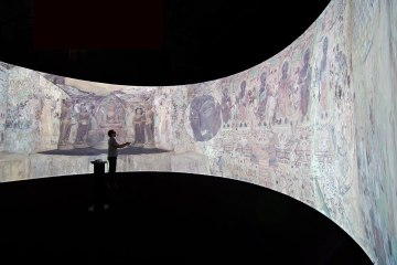 Visitors-are-immersed-in-a-large-360-degree-panoramic-projection-of-a-Mogao-cave-temple