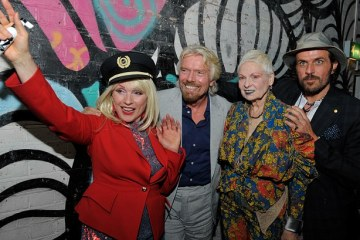 Seeing red: Vivienne Westwood joined Sir Richard Branson and Debbie Harry to launch her collection for Virgin Atlantic Read more: http://www.dailymail.co.uk/travel/article-2677648/Vivienne-Westwood-unveils-new-Virgin-Atlantic-uniform-design-star-studded-event.html#ixzz36Tx7uWZ6 Follow us: @MailOnline on Twitter | DailyMail on Facebook