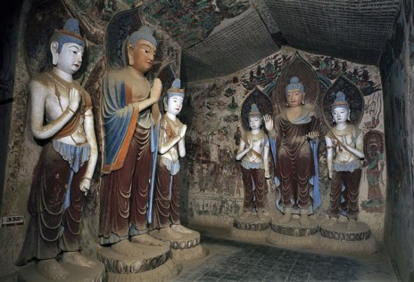 Sculptures of Buddha and attendants in Mogao cave number 332, from the early (Tang Dynasty, 618-704AD)