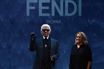 Karl Lagerfeld and Silvia Fendi acknowledge the audience at the end of the show for fashion house Fendi as part of the SS 2014 ready-to-wear collections