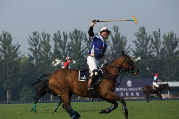 Liu ShiLai, founder of the Tang Polo Club playing in the 2014 China Open Polo Tournament