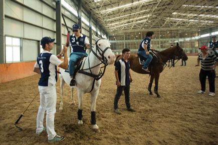 Royal Salute Polo Ambassador Malcolm Borwick teaches a polo clinic at the Tang Polo Club in Beijing