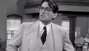 How does Atticus Finch show he is a good father?