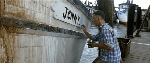 "Forrest Gump painting the text ""Jenny"" on the side of a boat"