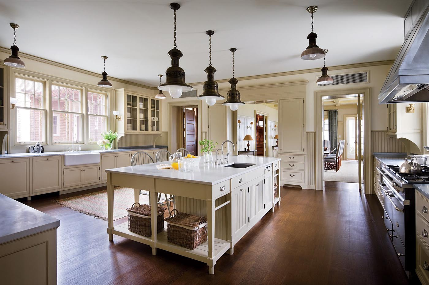 ... Decorated By Victoria Hagan Interiors, The Customized Cabinetry By  Ferguson U0026 Shamamian Meets The Vintage Italian Hanging Lights In The Sunlit  Kitchen.