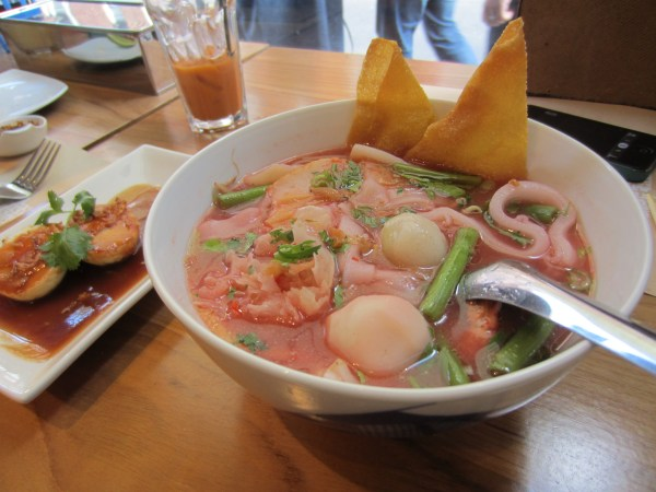pink noodles with fish balls