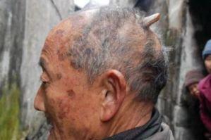 man with horn on head weird