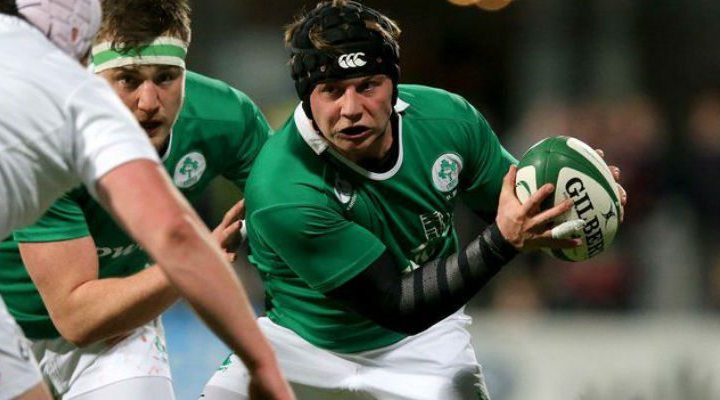 Queens University and Ulster's Zac McCall in action for Ireland against England