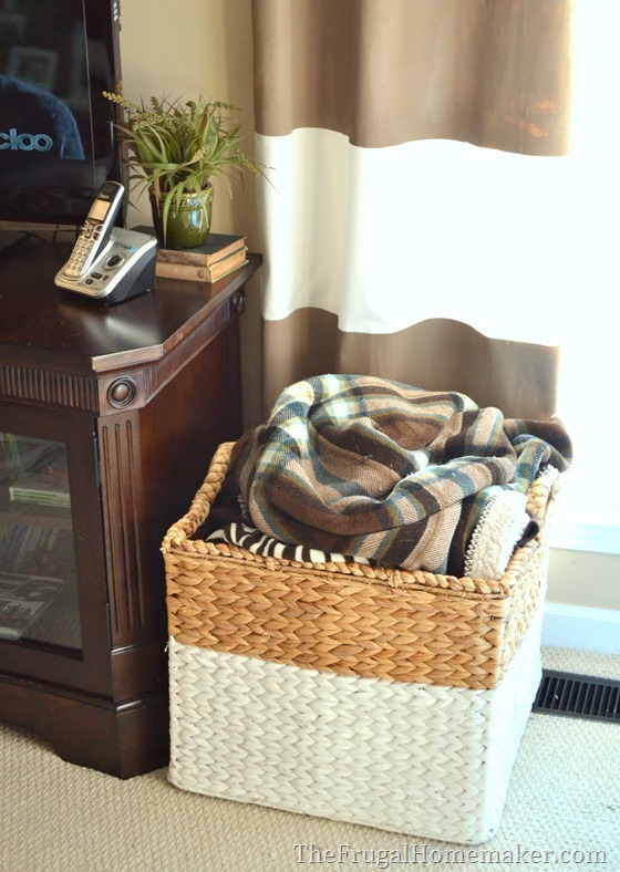 15+ ways to use open storage to organize your home - living room blanket storage