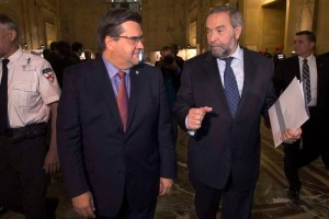 NDP Leader Tom Mulcair chats with Mayor Denis Coderre, left, at city hall during a campaign stop in Montreal on Wednesday, Sept. 23, 2015. THE CANADIAN PRESS/Andrew Vaughan
